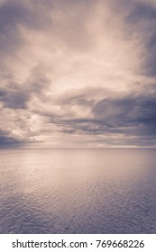 Minimalist idyllic shot of horizontal sea water and sky during cloudy day. Beauty of nature concept.