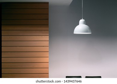 Minimalist interior background with wooden wall and a white lamp