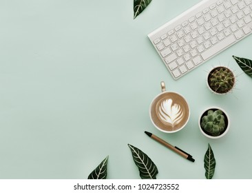 Minimalist Lifestyle For Website, Marketing, Social Media with coffee cup and keyboard. Home office table