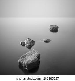 Minimalist misty landscape. Black and white.