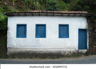 Minimalist Old House Facade with Blue and White