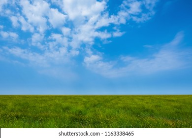 Minimalist picture of a green meadow with blue sky