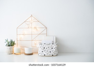 Minimalist scandinavian home decor, storage box and string light