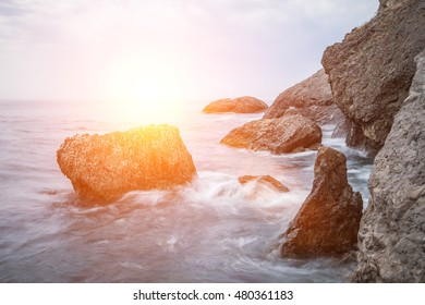 Minimalist seascape with sun ray and lens flare at morning