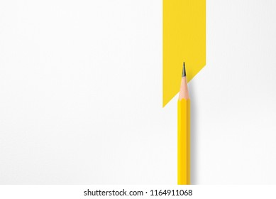 Minimalist template with copy space by top view close up macro photo of yellow pencil isolated on white textured paper and combine with yellow trapezoid. Flash light made smooth shadow from pencil.