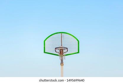 Minimalist view of basket against sky. Minimal basket in basketbal court against clear blue sky. Minimalism in basketball sport. Close-up view of Basket from the Sport Basketball in Spain, 2019.