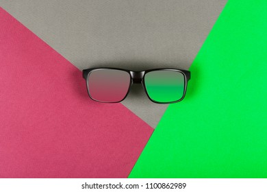 Minimalistic approach of sunglasses on multiple colour background