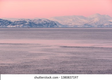 Minimalistic artic landscape under pink sky at sunset, Norway