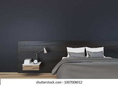 Minimalistic bedroom interior with black walls, a gray master bed and a bedside table. 3d rendering mock up