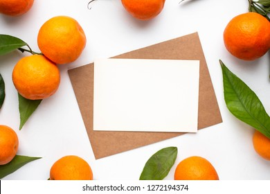 Minimalistic card mockup with tangerines, craft envelope, mandarines, flat lay, top view