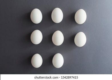 Minimalistic collection of white easter eggs on grey background