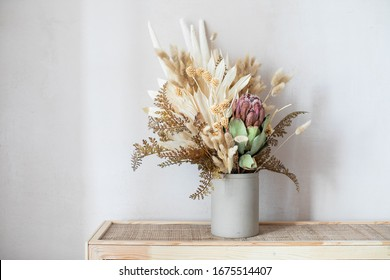 Minimalistic composition of dried flowers in cylindrical ceramic vase as home decoration.  - Shutterstock ID 1675514407