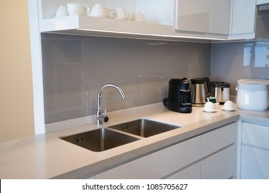 Minimalistic kitchen corner with appliances. Hotel room facilities including kettle, multicooker, coffeemaker, toaster, dish. City apartment concept