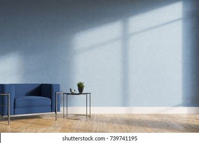 Minimalistic living room interior with blue walls, a wooden floor, a soft blue and silver armchair and a tiny coffee table. 3d rendering mock up