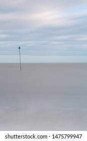 Minimalistic long exposure looking out to sea at Bawdsey, Suffolk, UK. Frame contains a lot of empty space
