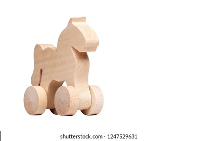 Minimalistic small wooden horse figure design on wheels, concept of trojan horse and mischief or simple child's toy