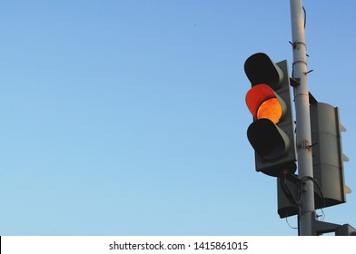 """Minimalistic traffic light on the background of the blue sky in the state """"Everything can be"""""""