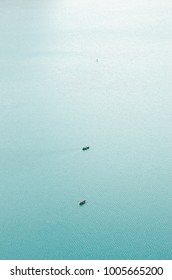 minimalistic two boats in quiet waters on the lake, aerial view