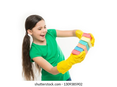 A minimum effort on cleaning the house. Small housekeeper holding dish sponges in rubber gloves. Cleaning and washing up. Small housemaid ready for household help. Cute kitchen maid. Household duties.
