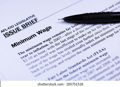 Minimum wage article close up with a pen
