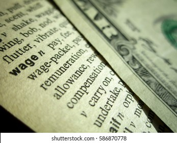 Minimum wage definition and one dollar banknote