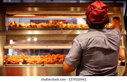 Minimum Wage Employee Works in a Fast Food Kitchen