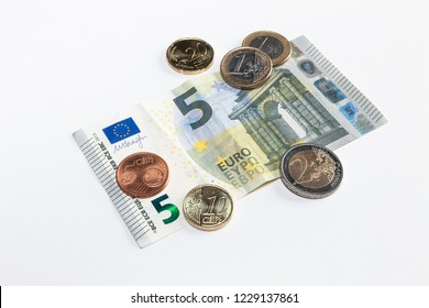 Minimum wage in Germany, 9,35 euro banknotes and coins  on white background isolated