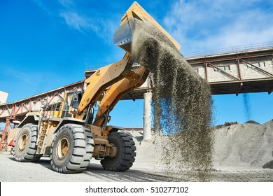Mining industry. heavy wheel loader loading granite rock or ore at crushing and sorting plant