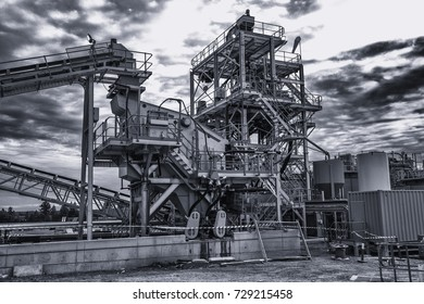 Mining infrastructure in black and white, mining plays a huge part in the nation economy with exports totaling  billion dollars.