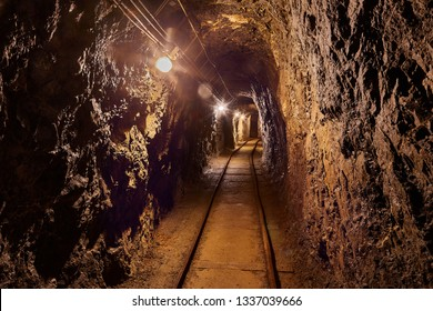 Mining tunnel with lights and rails