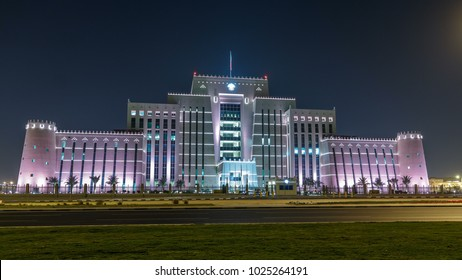 The Ministry of Interior in Doha night timelapse. View from park. Traffic on the road. Doha, Qatar, Middle East