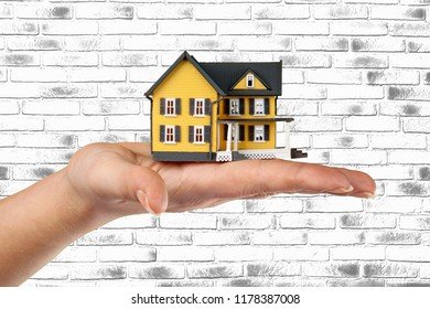 Miniture house model human hand