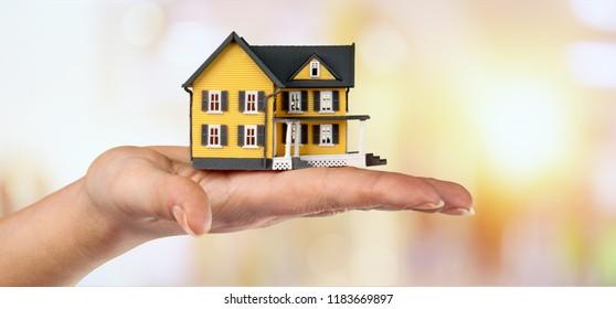 Miniture house model human hand displaying american