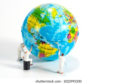 miniture people cleaning the world
