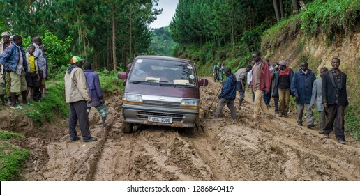Minivan stuck in the mud on a Rural road in southwestern Uganda, at the Bwindi Impenetrable Forest National Park, at the borders of Uganda, Congo and Rwanda, circa October 2012