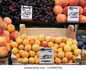 Minks/Belarus-July 04, 2015: Grapes and peaches for sale at Komarovsky marketplace