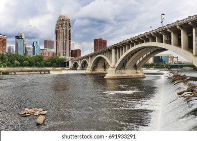 Minneapolis downtown skyline and Third Avenue Bridge above Saint Anthony Falls, Mississippi river. Midwest USA, Minnesota state.