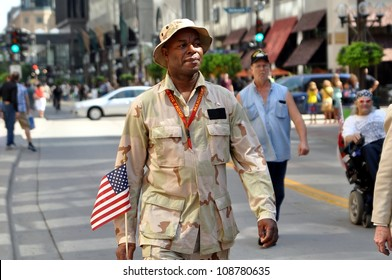 MINNEAPOLIS - JULY 28:  A proud veteran marches in the Twin Cities Heroes Parade on July 28, 2012, in Minneapolis.  The parade honors  post-9/11 veterans and active military.