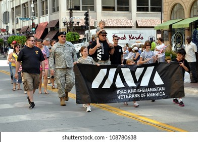 MINNEAPOLIS - JULY 28:  Veterans march in the Twin Cities Heroes Parade on July 28, 2012, in Minneapolis.  The parade honors post-9/11 veterans and active duty military.