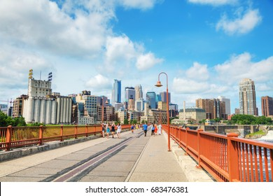 MINNEAPOLIS - JUNE 14: Downtown Minneapolis as seen from the famous stone arch bridge on June 14, 2017 in Minneapolis, MN.
