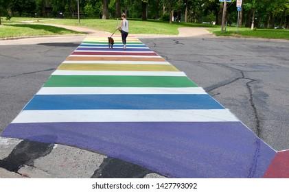 MINNEAPOLIS- JUNE 18:  Rainbow Crosswalk in Minneapolis, MN, on June 18, 2019.  Some streets in Minneapolis were painted rainbow colors to celebrate the Twin Cities Pride Festival.