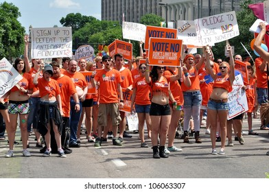 MINNEAPOLIS - JUNE 24:  Supporters of a No vote on the Mn. Same-Sex Amendment march in the Gay Pride Parade on June 24, 2012, in Minneapolis. The Amendment would validate only man-woman marriage.