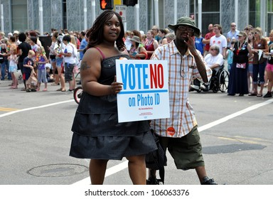 MINNEAPOLIS - JUNE 24:  Supporters of a No vote on Photo ID march in the Gay Pride Parade on June 24, 2012, in Minneapolis.  A Photo ID requirement for voting will be on the ballot in Mn. in November.