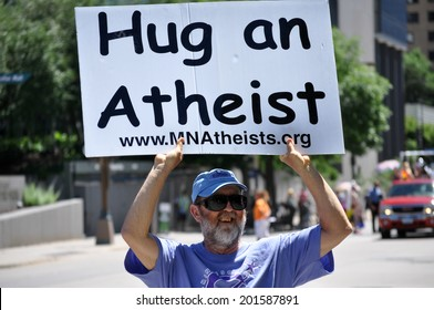 MINNEAPOLIS - JUNE 29:  A Minnesota Atheist carries a placard at the Twin Cities Gay Pride Parade on June 29, 2014, in Minneapolis.
