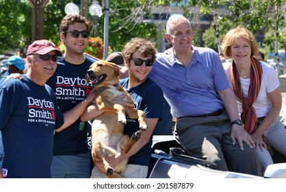 MINNEAPOLIS - JUNE 29: Minnesota Governor Mark Dayton and Lieutenant Governor Candidate Tina Smith pose for pictures in the Twin Cities Gay Pride Parade on June 29, 2014, in Minneapolis.