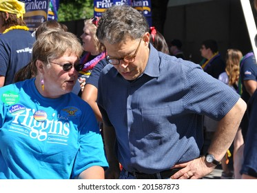 MINNEAPOLIS - JUNE 29: United States Senator Al Franken talking to a constituent at the Twin Cities Gay Pride Parade on June 29, 2014, in Minneapolis.