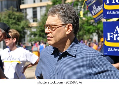 MINNEAPOLIS - JUNE 29: United States Senator Al Franken marching in the Twin Cities Gay Pride Parade on June 29, 2014, in Minneapolis.