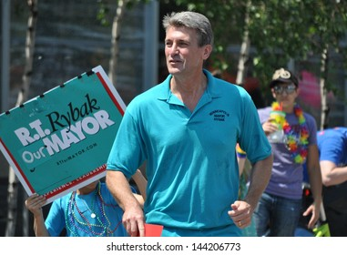 MINNEAPOLIS - JUNE 30:  Minneapolis Mayor R.T. Rybak marches in the Twin Cities Gay Pride on June 30, 2013, in Minneapolis.  The parade draws a crowd of around 300,000 people.