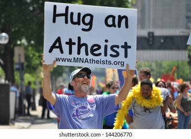 MINNEAPOLIS - JUNE 30:  An Unidentified Atheist marches in the Twin Cities Gay Pride Parade on June 30, 2013, in Minneapolis.