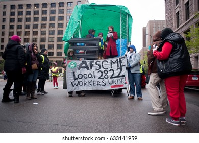 MINNEAPOLIS - MAY 1, 2017: Labor rights organizers speak in front of city hall in support of Hennepin County office employees union AFSCME Local 2822 on International Worker's Day, May 1, 2017.